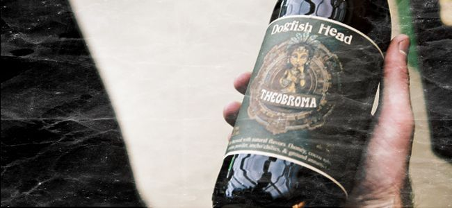 """Dogfish Head's Theobroma (translated into """"food of the gods"""") is brewed with Aztec cocoa powder and cocoa nibs, honey, chilies and annatto (fragrant tree seeds). ABV 9.0, IBU 8, limited availability."""