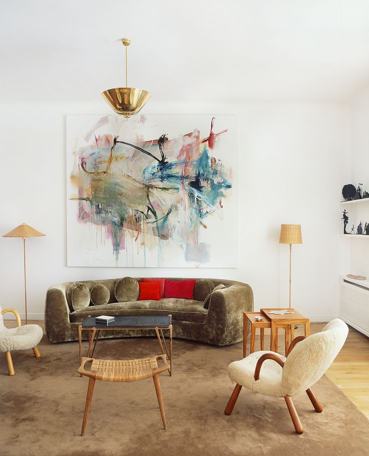 A painting by Albert Oehlen hangs in the Paris apartment, It's a beautiful living room decoration with the colorful wall art and chic furniture. It's a modern and classic living room decoration idea. http://www.urbanroad.com.au/