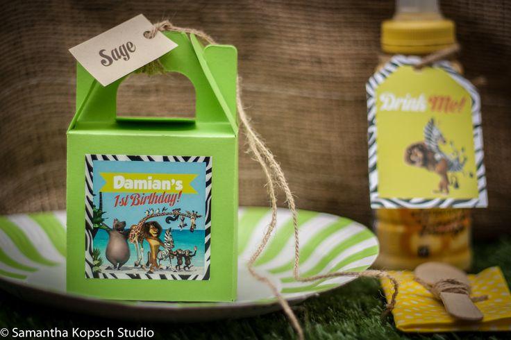 Make a personalised box filled with sweets and a jungle animal for every guest.