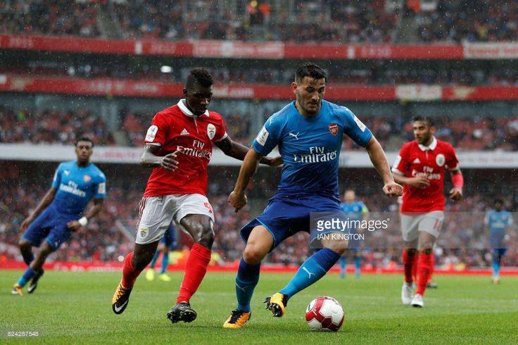 Benfica's Portuguese defender Aurelio Buta (L) chases Arsenal's German-born Bosnian defender Sead Kolasinac (R) during the pre-season friendly football match between Arsenal and Benfica at The Emirates Stadium in north London on July 29, 2017, the game is one of four matches played over two days for the Emirates Cup. / AFP PHOTO / Ian KINGTON / RESTRICTED TO EDITORIAL USE. No use with unauthorized audio, video, data, fixture lists, club/league logos or 'live' services. Online in-match use…