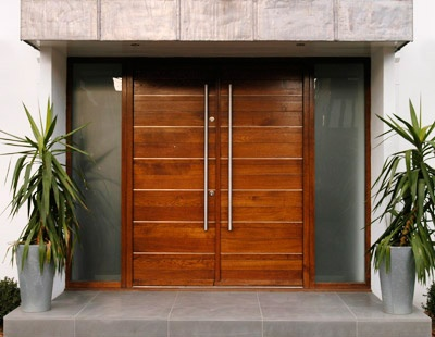Contemporary double front doors. Beautiful cedar doors with opaque glass sidelight windows on both sides.