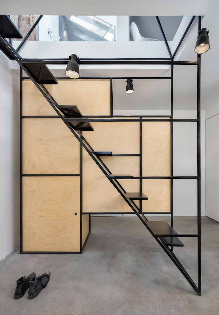 DontDIY installs black wireframe staircase inside house and atelier in Bulgaria