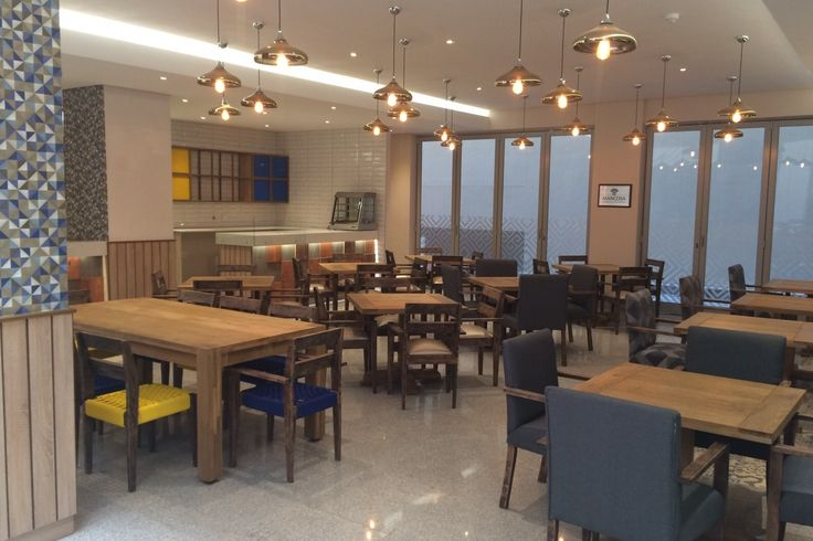 The student dining room at Durban's prestigious Mancosa campus is awash with HOMEWOOD dining furniture.