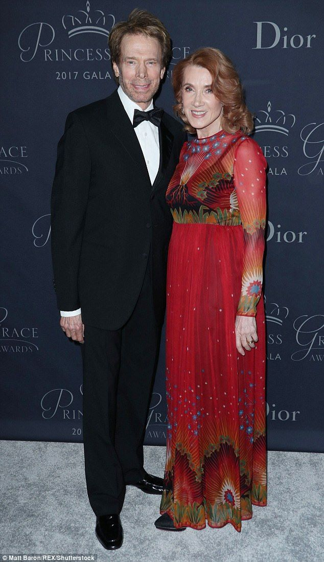 They're on fire! Jerry Bruckheimer was joined by his stunning wife Linda, who sported a flowing red dress with a volcano design