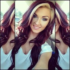 dark red hair, blonde streak  I kind of really like this! my red is lighter but it would look cute too..... hhmmmm