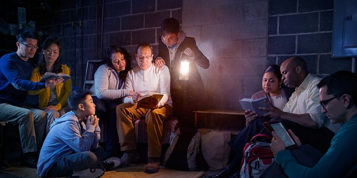 In an area where their work is restricted, Jehovah's Witnesses hold a meeting in a dark basement