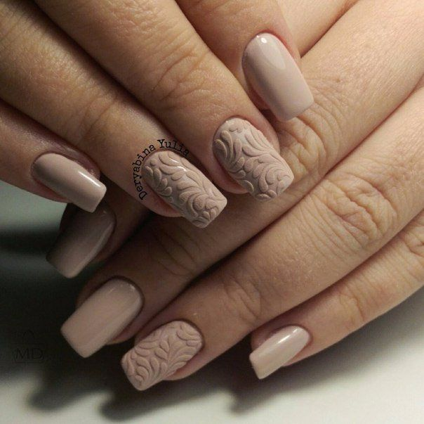 It's very cute and smart variant of design of nails, made in warm pastel shades. A milky-beige gel-varnish looks great with a raised matte drawing, depicti