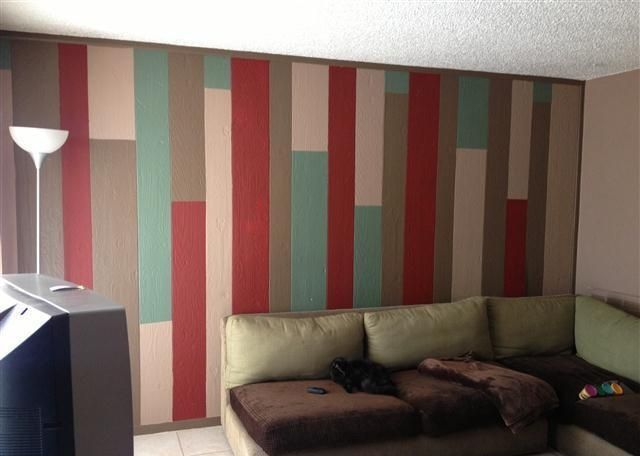 What to do with old wood paneling? Paint it in different colors.
