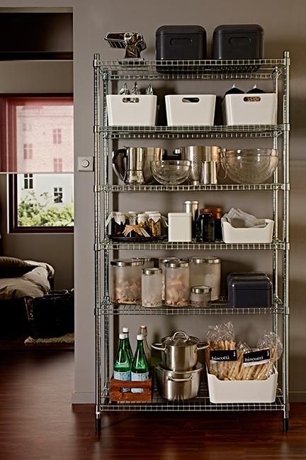 Ikea OMAR shelving, comes in a variety of widths/heights, incl. narrower than IVAR. Can be cut to size with a pipe cutter.