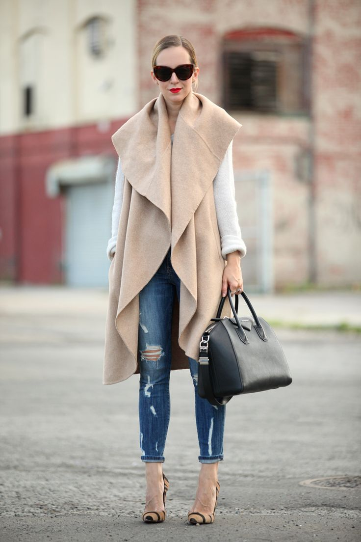 An oversized, wooly vest is a great way to keep warm without adding too much bulk.