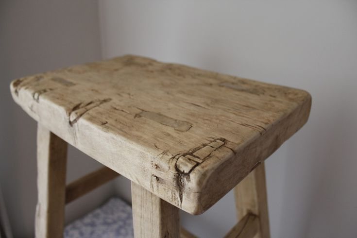 reclaimed wood counter, turned stool.