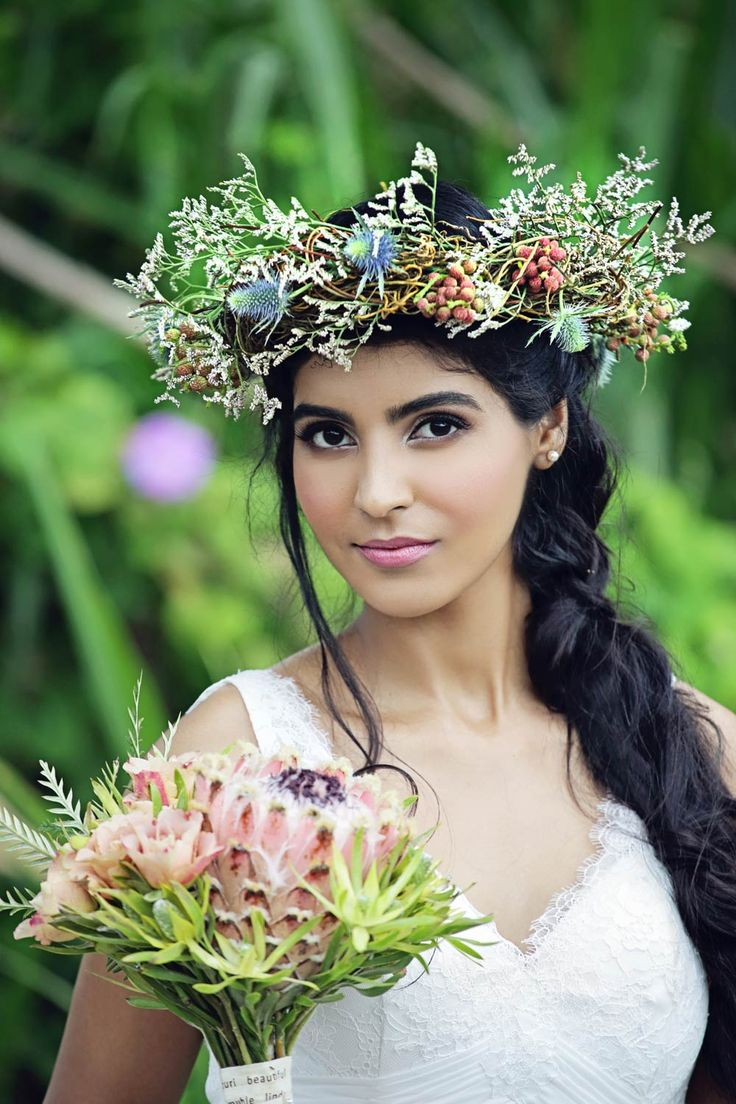 Beautiful romantic bridal look. Flower crown creating a whimsical, organic, Bohomian inspired look. South African bouquets. ADORN summer 2015 collection Designer wedding dress | Carita Adams | www.caritaadams.com | Lauren Oliver photography | Pro make-up | blooms & flower crown by Talloula | Maroupi venue