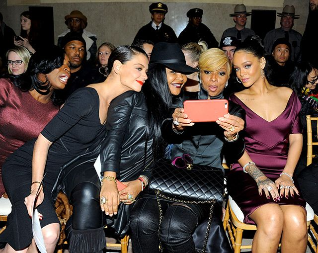 Uzo Aduba and Katie Holmes craned their necks to be included in a selfie with celeb stylist Misa Hylton, Mary J. Blige, and Rihanna as all five ladies sat in the front row of the Zac Posen NYFW show at Vanderbilt Hall in NYC Feb. 16.