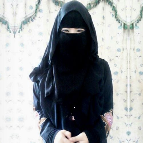 Young Muslimah Smiling in Niqab and Abaya
