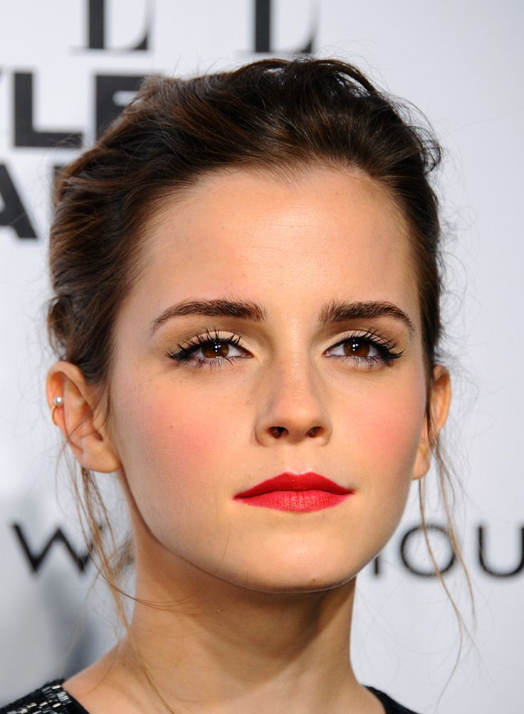 Emma Watson's windswept updo and crimson pout.