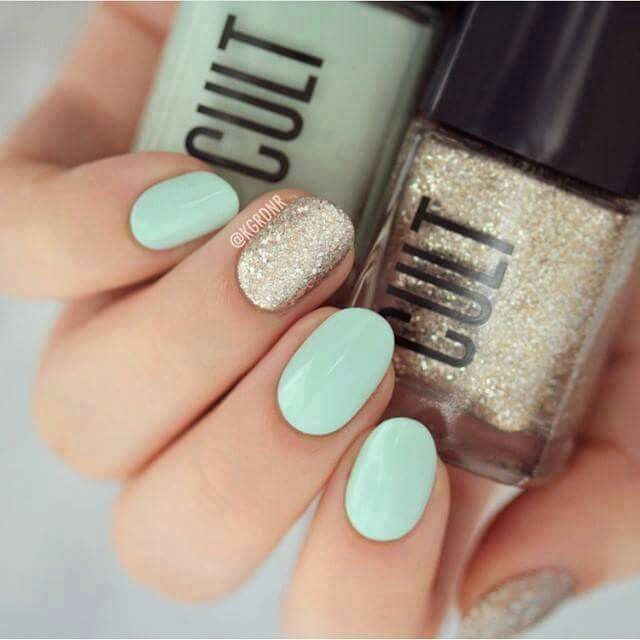 mint green nails with gold accent nail