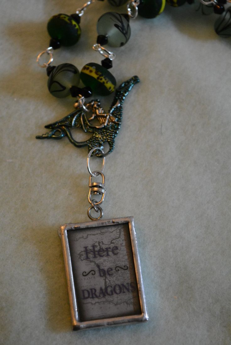 Here Be Dragons picture frame necklace dragon charm green glass beads 24 in chain picture of dragon ink stained dragon green by hudathotjewelry on Etsy