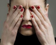 woman rubbing her eyes Find out why you see flashes and spots