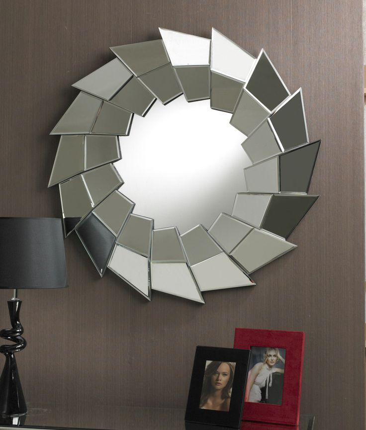 The modern round mirror features a dramatic jagged border of clear bevelled glass angled sections, each overlapping the next, with the border set above the main mirror, giving a multifacet effect.It's razor-sparp apprence makes it a cool look for any room. The mirror is set on a black MDF backboard. Diameter: 90cm http://www.totalmirrors.com/round-mirrors/205-round-jagged-multifacet-border-mirror-90cm-diameter-5055157613717.html
