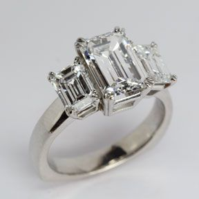 Three stone emerald cut diamond ring from Oliver Smith Jeweler.