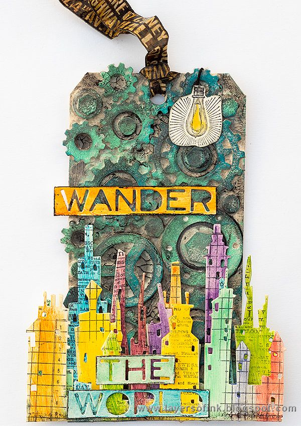 Wander the World Mixed Media Tag Tutorial on the Sizzix blog by Anna-Karin Evaldsson. Made with Tim Holtz cityscape dies, Tim's stamps by Stamper's Anonymous and Ranger inks, paints and media.