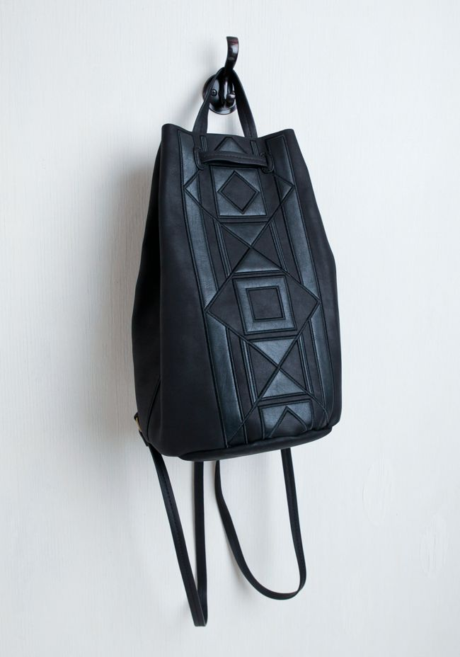 The front features a cool geometric design to fill all your luxe-boho needs.