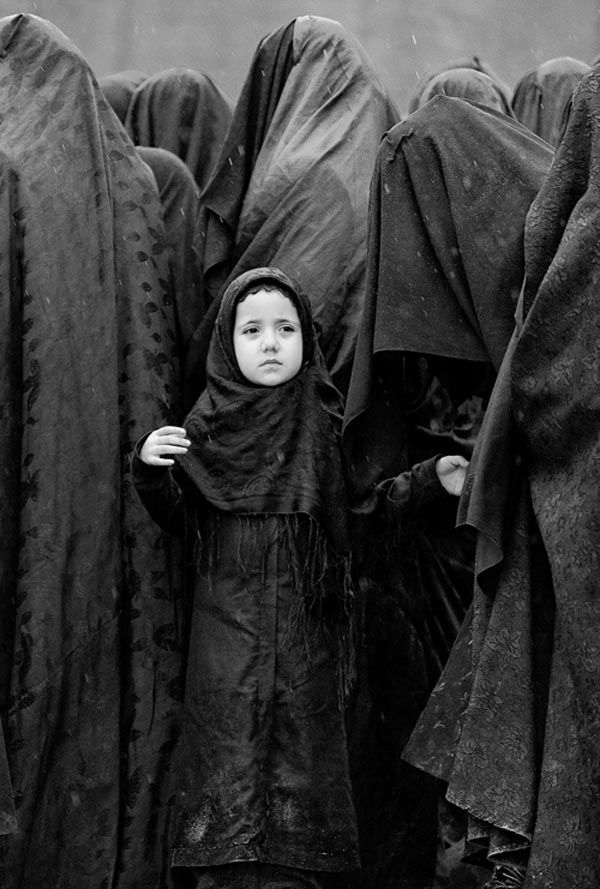 She is already being forced to understand what it means to be female in that culture.....Childhood innocence by Yavuz Sariyildiz