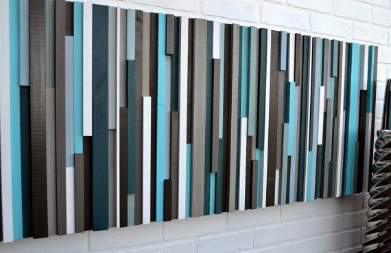 Artful headboard in turquoise, blues, teal, grays, brown and white seems to…