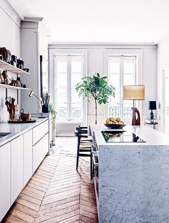 If there was one kitchen that defined French elegance, it's this one. The traditional architectural detailing is the ideal framework for this stylish yet simple space. The marble island is an...