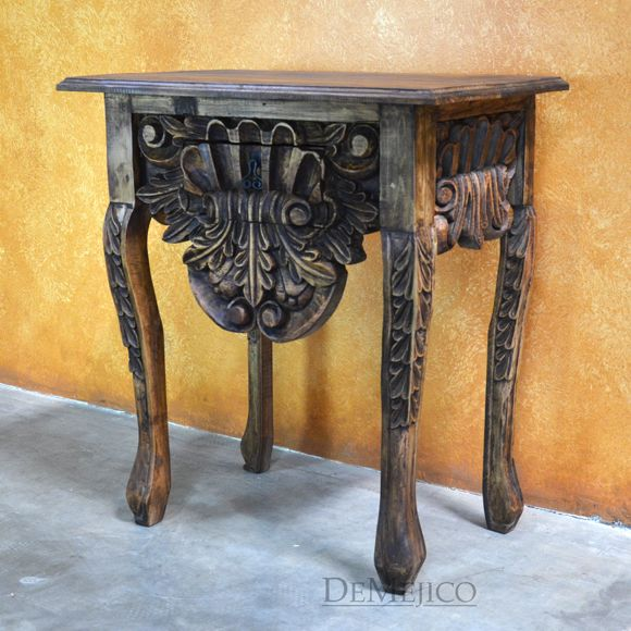 The Pequeña Consola is a hand carved console table, from solid pinewood. A smooth top & arched legs, this small console table shows beautifully detailing.