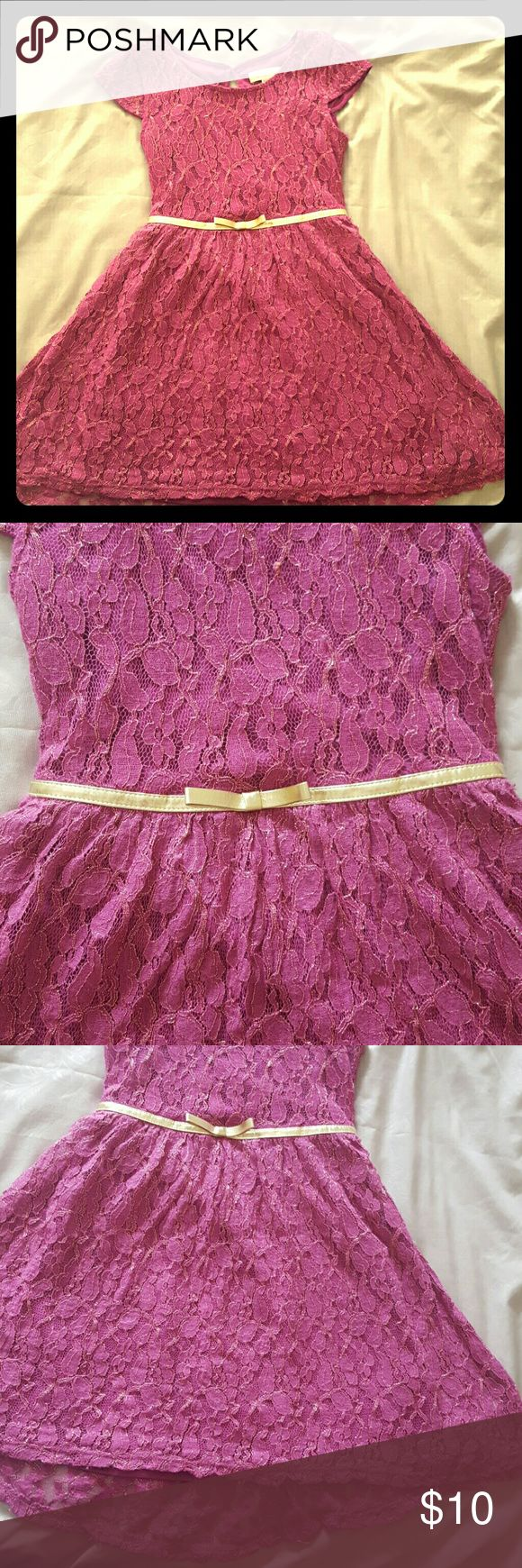 Girls Lacy Purple and Gold Dress Very cute girls Xhileration dress from Target. There's a built in slip underneath. It's a purple pink color.. not quite fushia but not quite purple.  The gold belt is part of the dress detail, totally sewn in. The lace has gold detail throughout. This was worn to a Father daughter dance at school. It's a size Medium 7/8. Xhilaration Dresses Formal