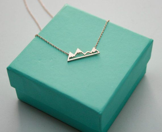 This necklace says lets go on an adventure! Love the snowy mountain tops in this simple and elegant pendant necklace. Be sure to check out the