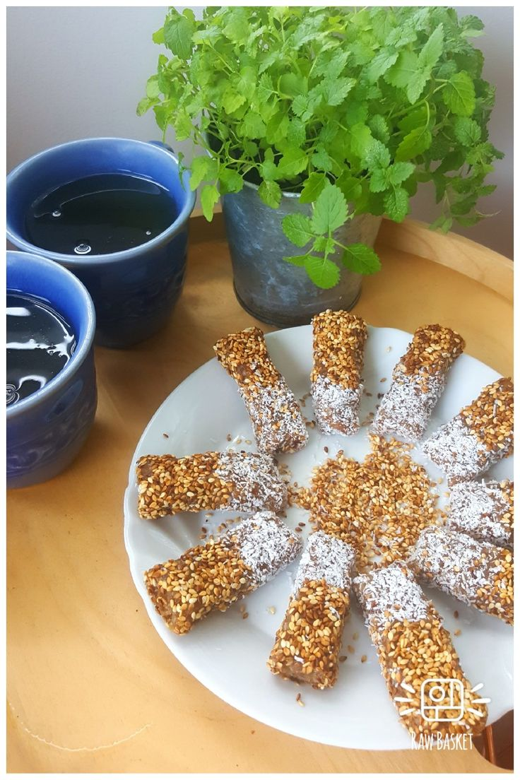 Sesame bites  Blend medjool dates, tahini, almond meal, sesame seeds. Freeze in a trey then toast some coconut and sesame seeds. Cut the mixture into bars roll in sesame seeds and coconut and serve once set.