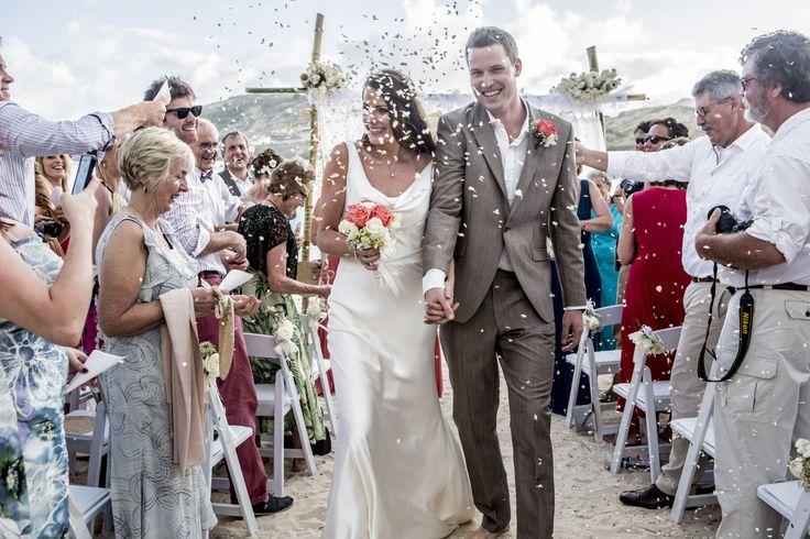 Confetti Shot - St James Club Antigua - Suzanne Neville gown - Beach Wedding