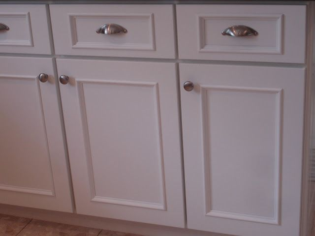 Add Some Molding And New Fixtures To Update Those Boring Flat Cabinets