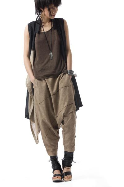 Natural dark colours in alluring and cozy form. Everything is oversized and comfy. Love the detail on the neck.