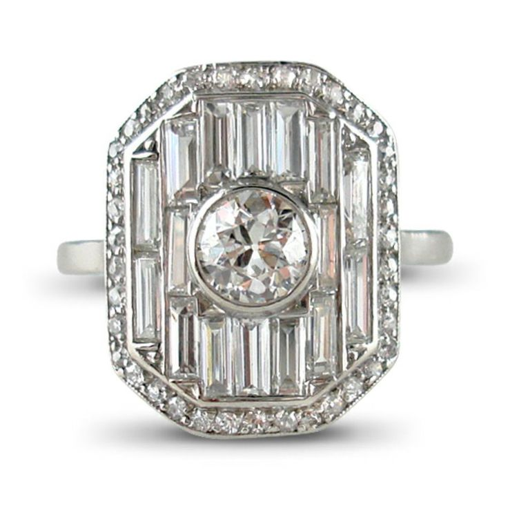 Art Deco diamond panel ring, by Lacloche Freres, designed as a pavé -set baguette-cut diamond convex cut-cornered rectangular panel trimmed with small single-cut diamonds and set to the centre with a single-brilliant-cut diamond collet,mounted in platinum, numbered