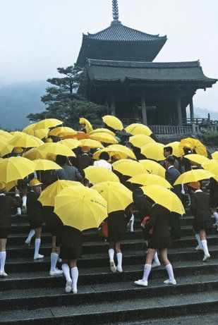KYOTO, Japan—Schoolchildren with umbrellas visiting a temple, 1977.  © Thomas Hoepker / Magnum Photos