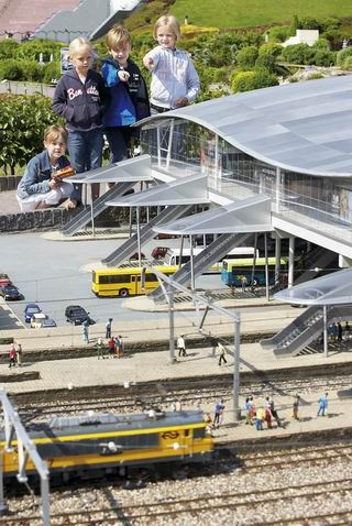 Humongous children ransack transit station in Den Haag. Oh, wait - it's just Madurodam!