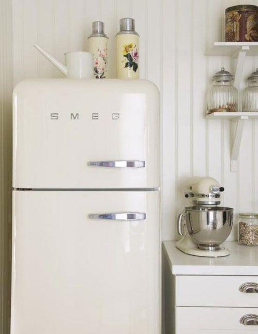 Retro kitchen with Smeg refrigerator via SF Girl By Bay. Photo by Magnus Selander Photography.