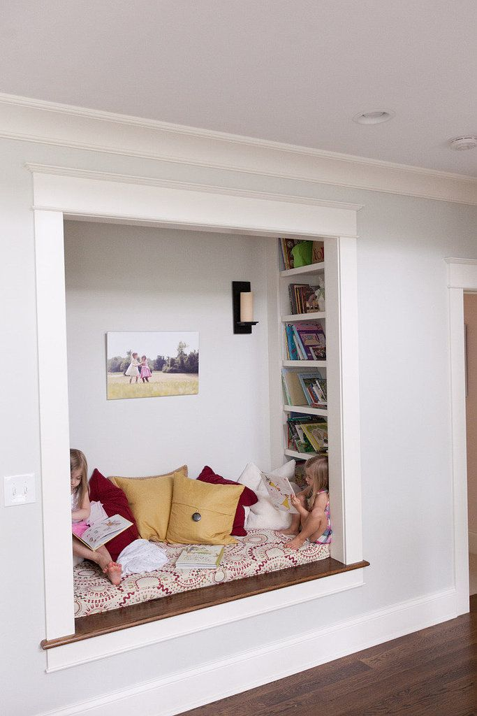 If you have a nook or window seat, install shelving into the sides of the inset area. Now you've got yourself a built-in reading area. Photo by Cheryl M. Photography via Style Me Pretty