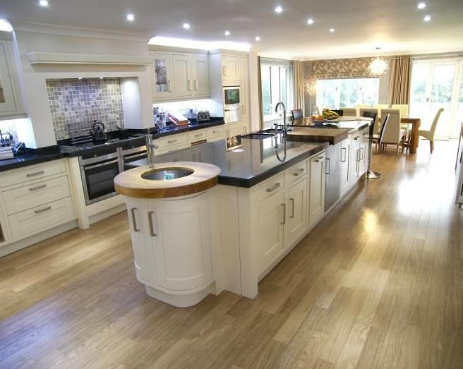 Photo of contemporary fresh large open plan beige black for Kitchen flooring ideas uk
