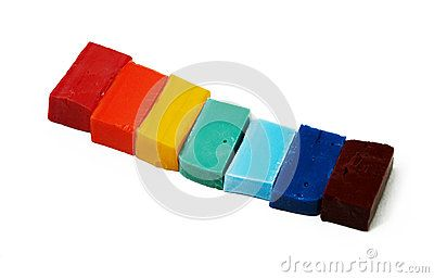 Smalt tiles of different colors arranged in rainbow order on white background