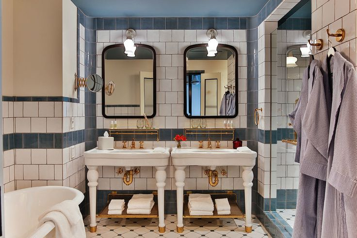 Hotel Emma's bathroom is so chic. Best of all, it comes with a shower and tub combo. The dual sink and vanity mirrors are a great touch as well.