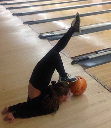 Mackenzie bowling...., you know.. As you do, bowl upsides own flipping your body backwards