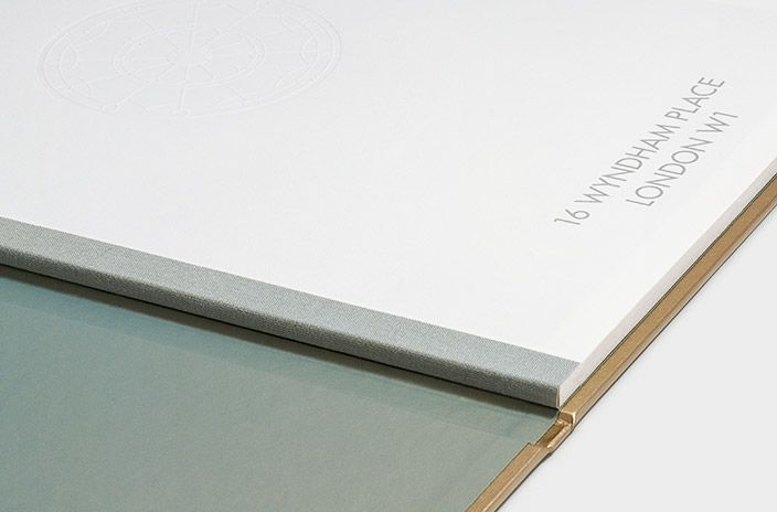 Hard-back coffee-table book with swiss-bound spine, iridescent end papers, and debossed fan-light motif; designed by Phage to launch Studioloop's latest luxury property renovation.
