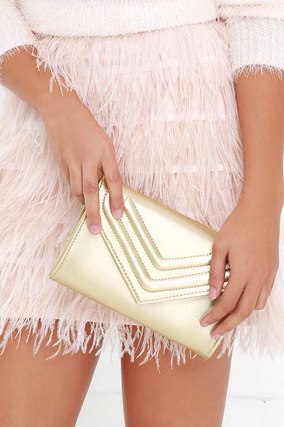 You can expect a line of dance partners when you show up to the party in that dazzling gown, and with the Dance Card Gold Clutch under your arm
