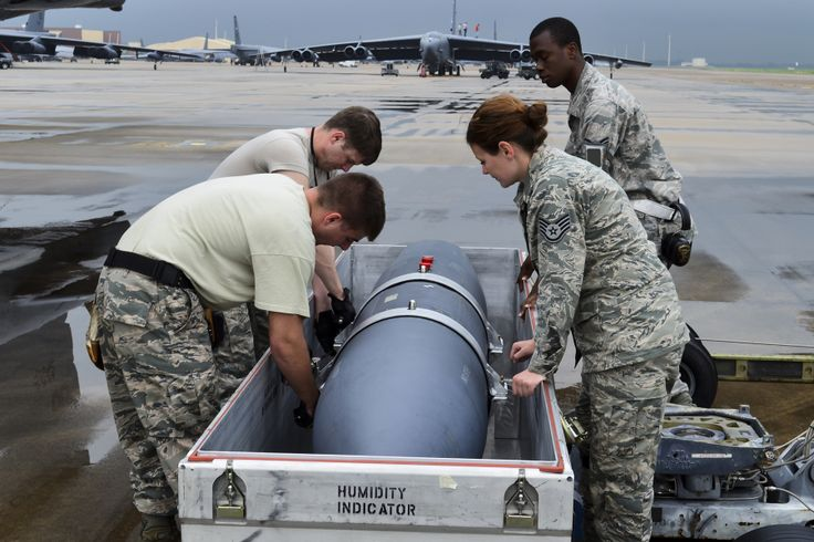 Weapons technicians assigned to the 2nd Aircraft Maintenance Squadron prepare an AN/ASQ-236 Radar Pod for loading onto a B-52H Stratofortress, April 14, 2014, Barksdale Air Force Base, Louisiana. The pod is operational on the F-15E Strike Eagle and is undergoing B-52 testing at Barksdale. (U.S. Air Force photo by Master Sgt. John Paxton/Released)