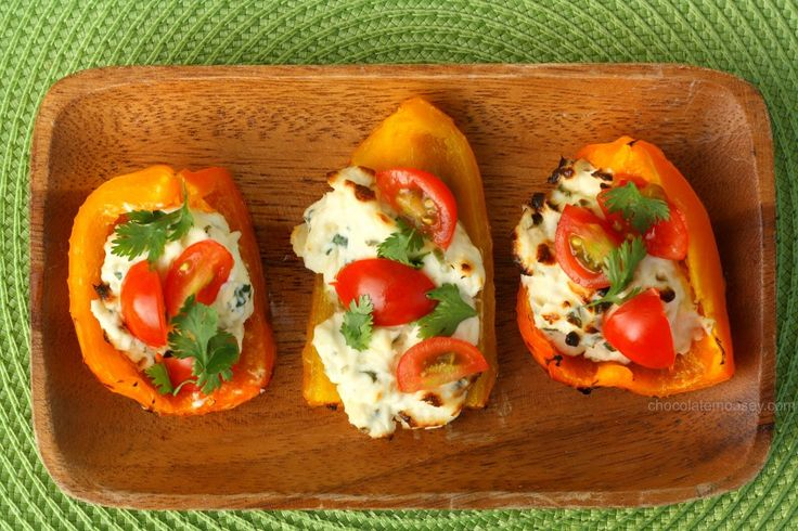 Sweet grilled (or broiled) bell pepper boats stuffed with cream cheese, basil, and chives then topped with tomatoes and cilantro make a great, fresh appetizer.