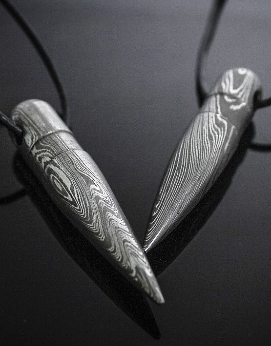 Cal. 50 Bullet Necklace made of hand-forged Damascus Steel